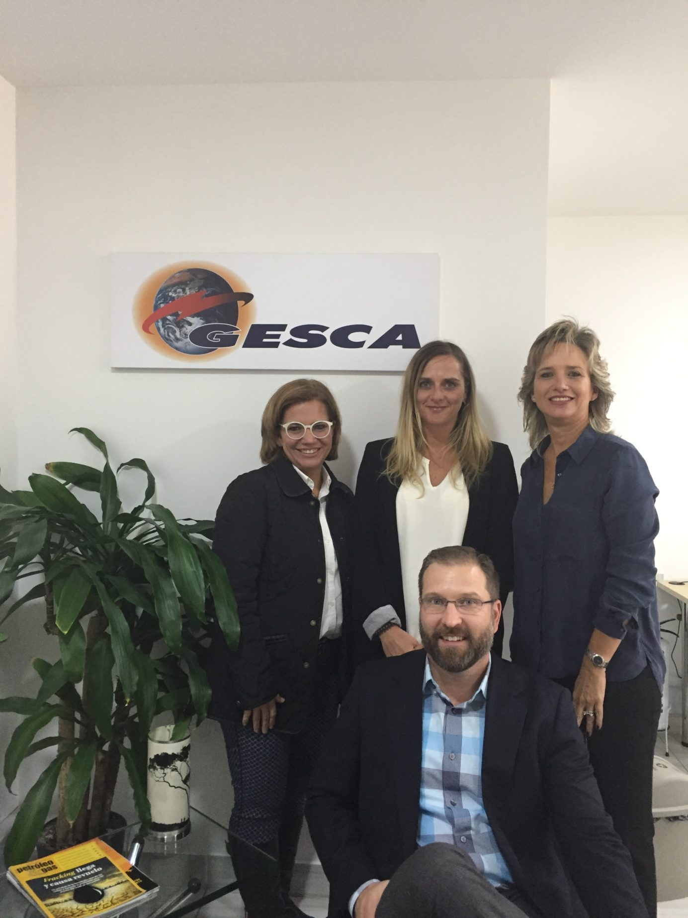 Tendeka staff and agents in front of GESCA sign