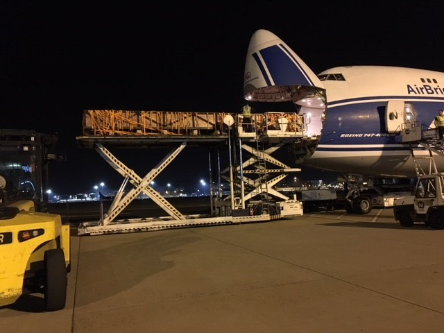 Cargo being loaded into the front of a plane