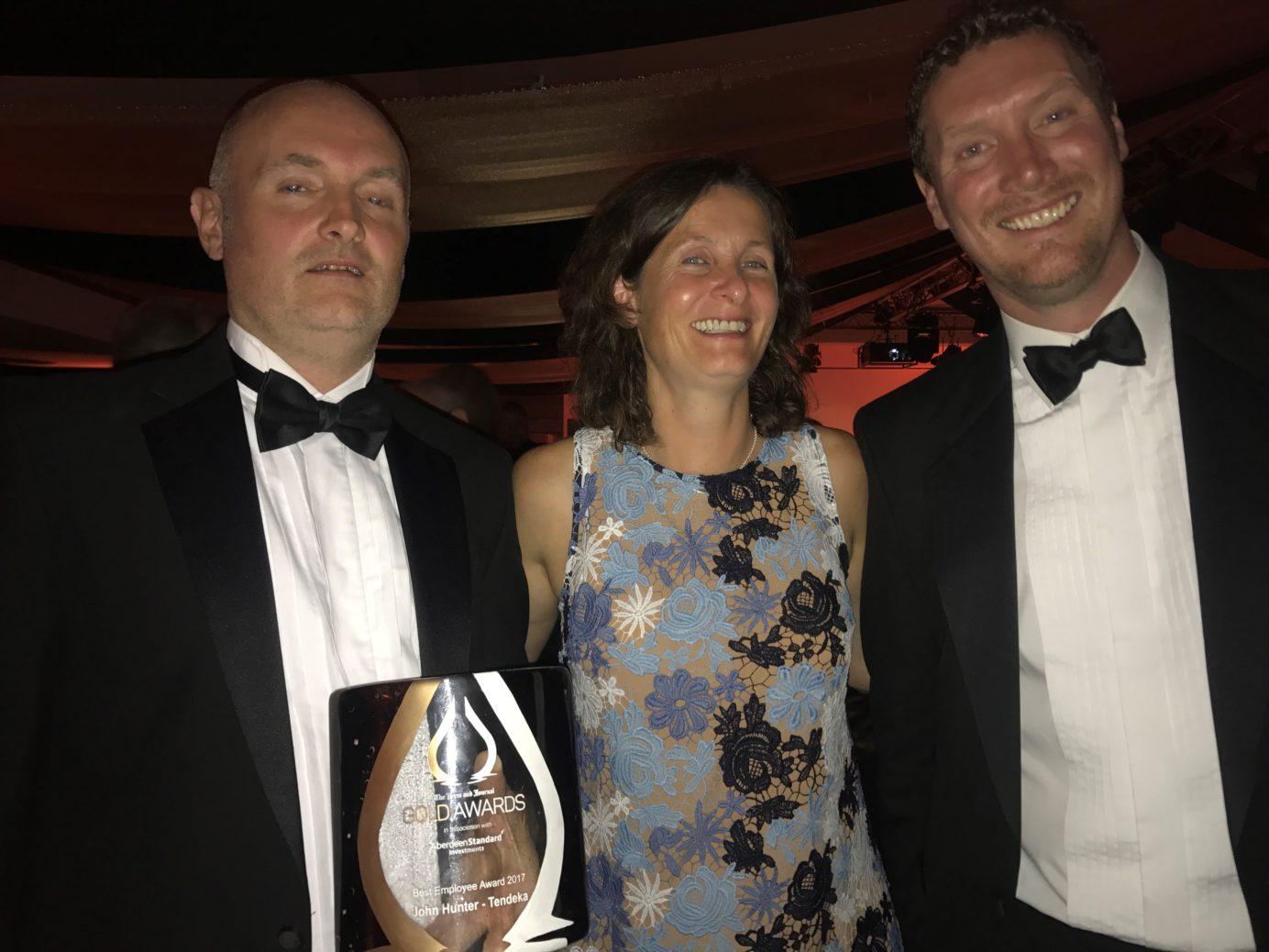 Annabel Green and 2 holidng an award