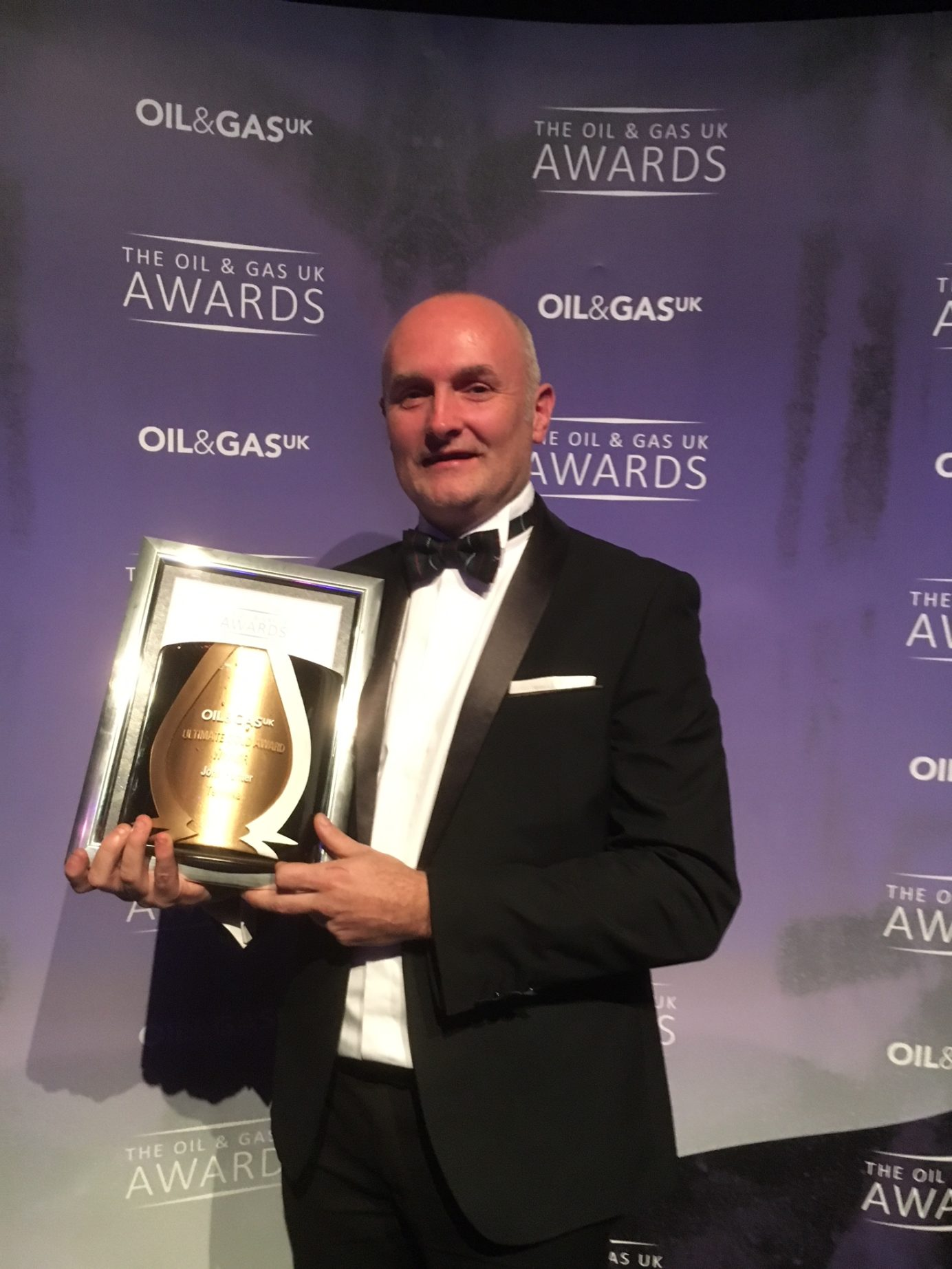 man holding award at the Oil & Gas UK Awards