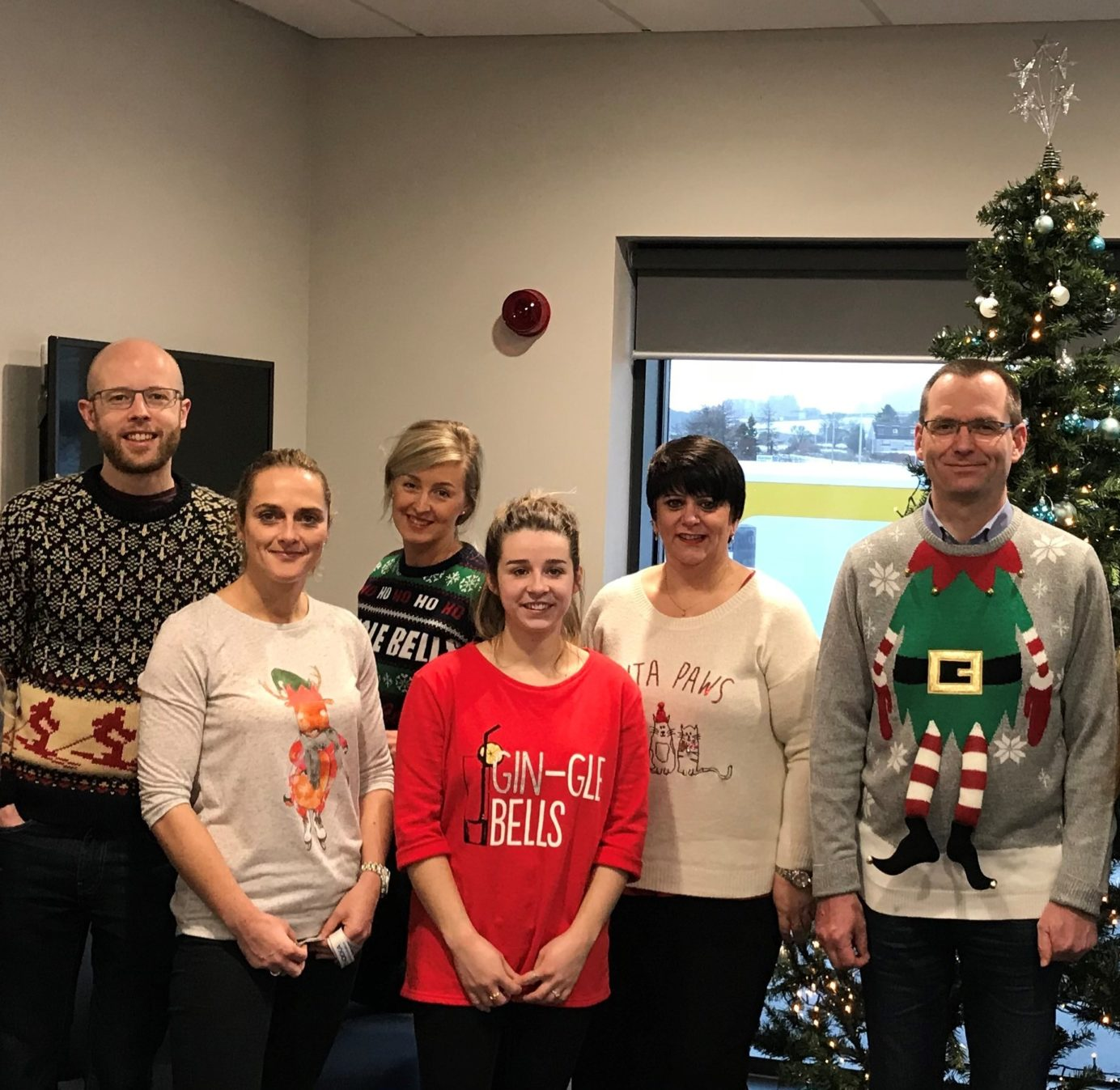 A team from Tendeka wearing Christmas Jumpers
