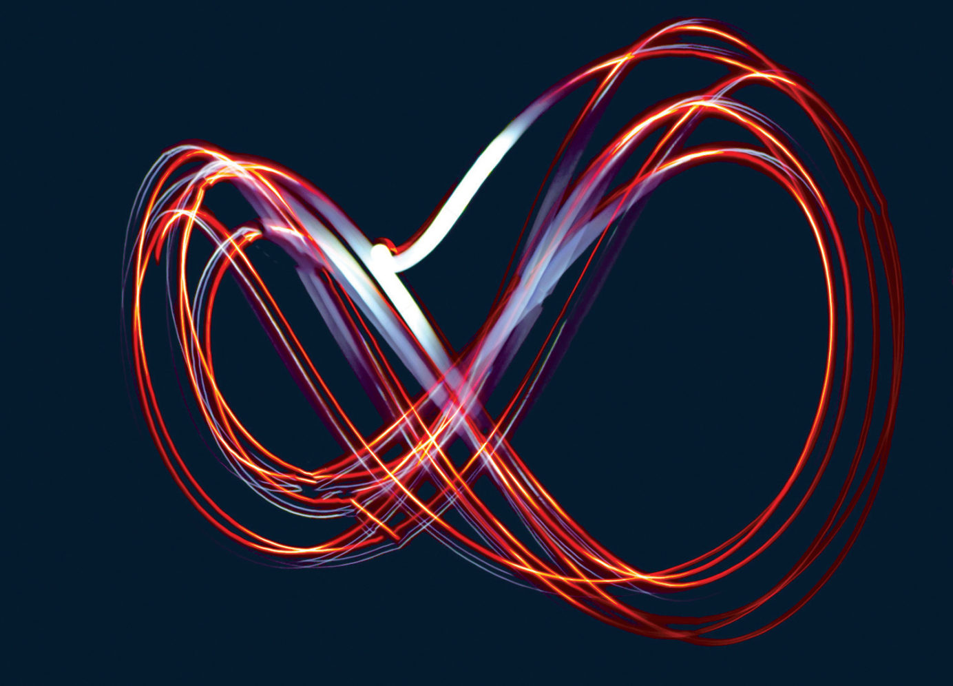 infinity symbol drawn with coloured light